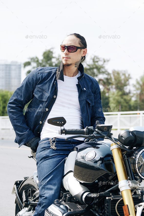 Handsome man sitting on motorcycle - Stock Photo - Images