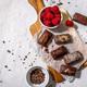 Dark handmade chocolate stack, coconut chips, rasberries and nuts - PhotoDune Item for Sale