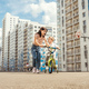 Boy rides a bike with his mother. - PhotoDune Item for Sale
