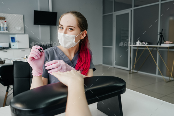 Process of manicure in salon. Young manicurist. - Stock Photo - Images