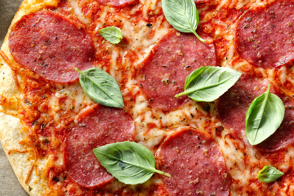 Salami pizza with cheese macro - Stock Photo - Images