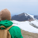 Tourist with backpack in snowy mountains - PhotoDune Item for Sale