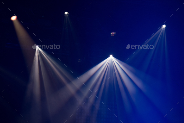 Blue stage lights glowing in the dark. Live music festival concept background - Stock Photo - Images