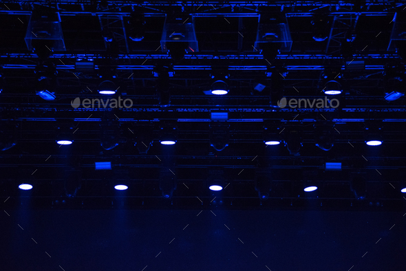 Stage lights glowing in the dark. Live music festival concept background - Stock Photo - Images