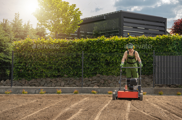 Lawn Aeration and Preparing For Grass Seeding - Stock Photo - Images