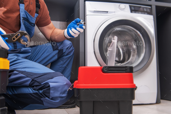 Professional Worker Installing Washing Machine - Stock Photo - Images