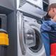 Technician Repairs Broken Washing Machine - PhotoDune Item for Sale