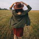 Beautiful carefree woman in hat walking in evening summer field. Relaxing in countryside. Happiness - PhotoDune Item for Sale