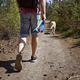 Man walking with dog on footpath in forest - PhotoDune Item for Sale