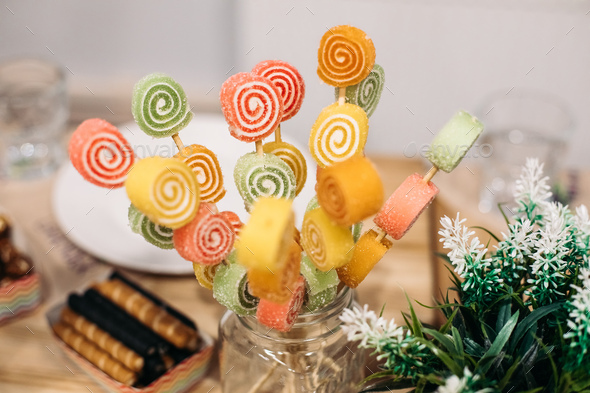 Delicious marmelade on sticks - Stock Photo - Images