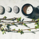 beautiful spring cherry branches, natural candle and grey stones - PhotoDune Item for Sale