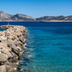 Stone breakwater with a lighthouse aerial drone view.Koufonisia Cyclades islands, Greece - PhotoDune Item for Sale