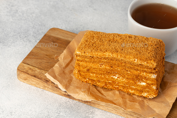 Piece of honey cake on kitchen table - Stock Photo - Images