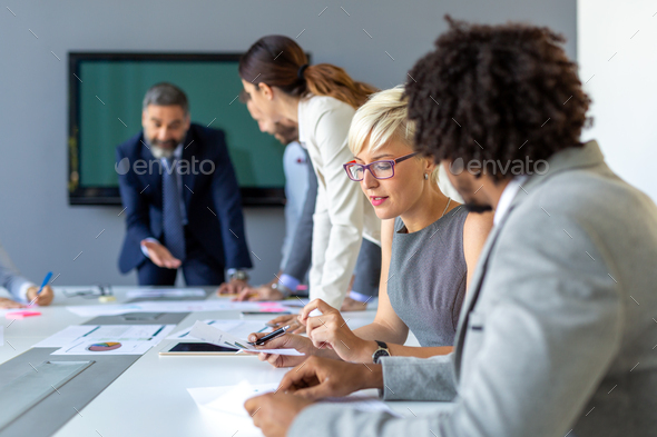 Group of coworkers working together on business project in modern office - Stock Photo - Images