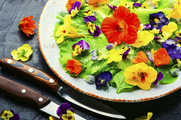 Edible flower salad in the plate - Stock Photo - Images