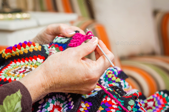Hands of woman knitting a vintage wool quilt - Stock Photo - Images