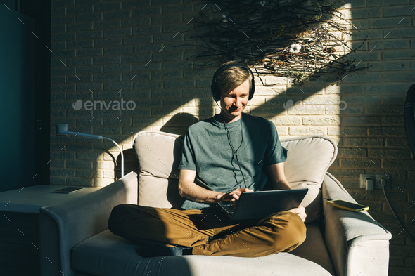 Man work with notebook at home. Sunny. - Stock Photo - Images