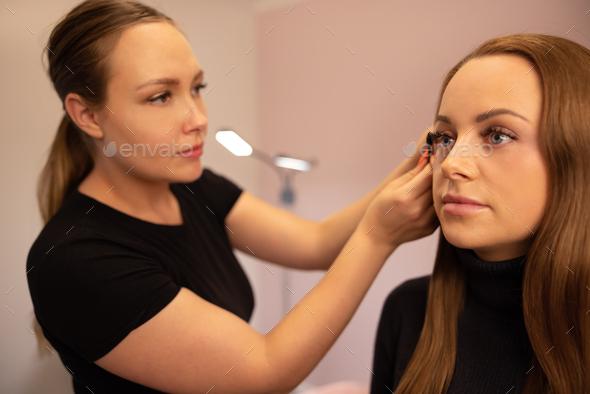 Female Specialist Using Mascara On Customer's False Eyelashes - Stock Photo - Images