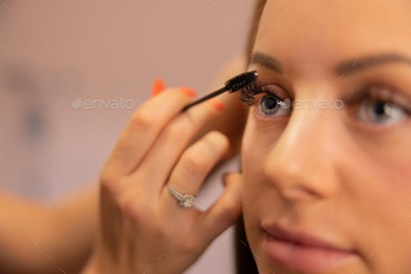 Hand Of Beautician Using Mascara On Customer's False Eyelashes - Stock Photo - Images