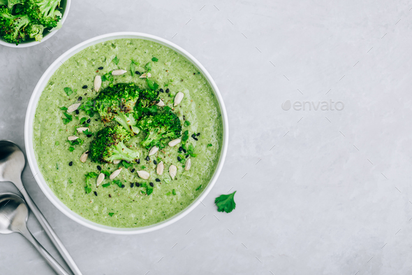Broccoli cream soup with sunflower and sesame seeds. - Stock Photo - Images