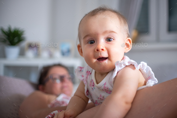 A mother is lying with the toddler baby - Stock Photo - Images