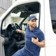 Delivery person with mobile phone gets out of the car - PhotoDune Item for Sale