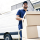 Delivery driver moving parcels on hand truck - PhotoDune Item for Sale