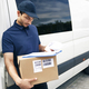 Courier checking the shipping address - PhotoDune Item for Sale