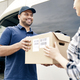 Delivery person giving boxes to woman - PhotoDune Item for Sale