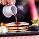 Sweet pancakes dripped with maple syrup in american restaurant - PhotoDune Item for Sale