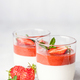 Two Panna Cotta Desserts served in Glasses with Strawberry Sauce. - PhotoDune Item for Sale