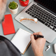 Man writing  TO DO LIST near laptop on a grey office desk close up - PhotoDune Item for Sale