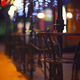Fences and blurred night lights decorations of the bar on background. Christmas time in the city. - PhotoDune Item for Sale