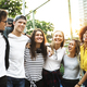Smiling happy young adult friends arms around shoulder outdoors friendship and connection concept - PhotoDune Item for Sale