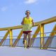 Young athlete running down a yellow bridge outdoors - PhotoDune Item for Sale