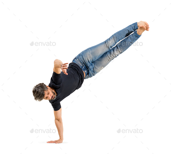 Fit athletic man doing a hip hop balancing pose - Stock Photo - Images