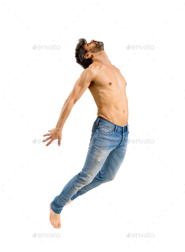 Fit shirtless barefoot man leaping in the air - Stock Photo - Images