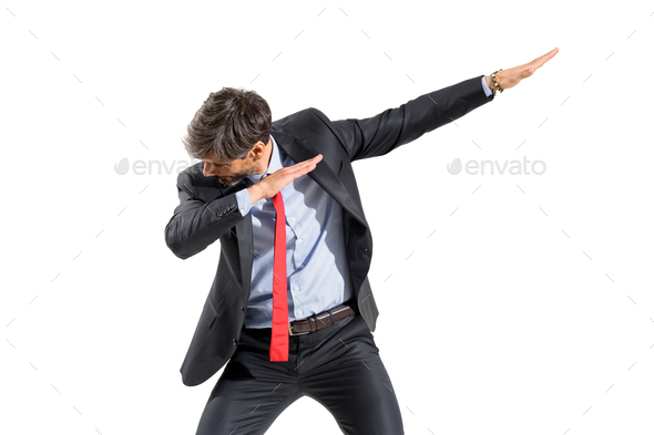 Businessman in suit doing a dab dance pose - Stock Photo - Images