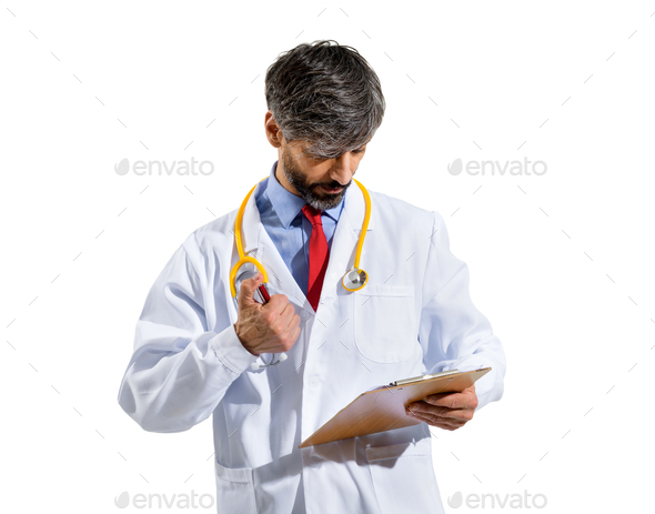 Doctor consulting patient records or notes on a clipboard - Stock Photo - Images