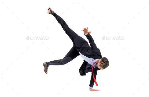 Stylish businessman in suit doing hip-hop dancing - Stock Photo - Images