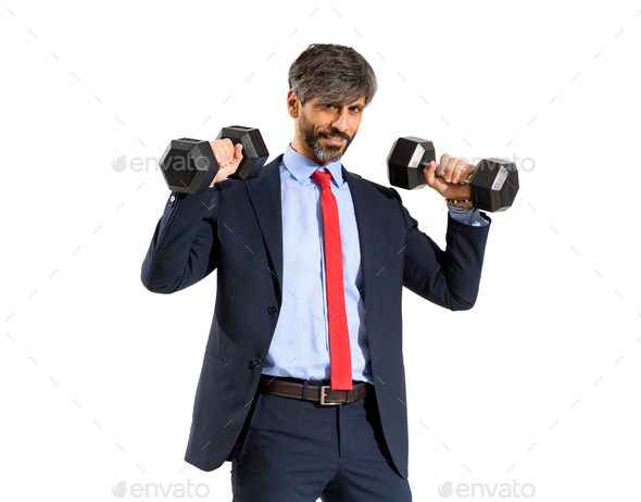 Stylish fit businessman in suit working out with weights - Stock Photo - Images