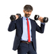 Stylish fit businessman in suit working out with weights - PhotoDune Item for Sale