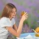 Smiling woman enjoying meal in lavender field - PhotoDune Item for Sale