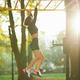Woman hanging on horizontal bar during workout outdoors - PhotoDune Item for Sale