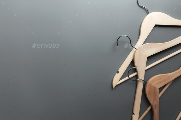 Black Friday or clothing industry concept on gray background with wooden hangers - Stock Photo - Images