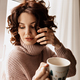 Close up inside portrait of romantic lovely girl with curly hair wearing soft sweater - PhotoDune Item for Sale