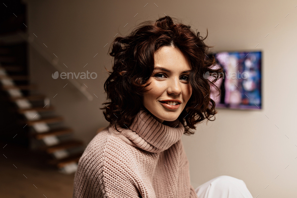 Close up inside portrait of happy smiling woman. Pleased brunette woman posing with  smile at home - Stock Photo - Images