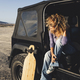 Woman travel alone with black car and long board table on the wild road- journey and adventure - PhotoDune Item for Sale