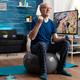 Senior man holding dumbbells doing arms exercise streching body muscles - PhotoDune Item for Sale