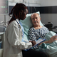 African american doctor in hospital room discussing diagnosis - PhotoDune Item for Sale